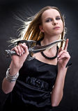 Blond young girl holding dagger. Blond young girl holding old dagger stock photos