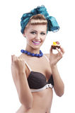 Blond young girl holding pastry Stock Photos