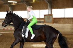 Blond young girl is vaulting Stock Photos