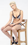 Blond young slender woman with short hair in an elegant lingerie Royalty Free Stock Images