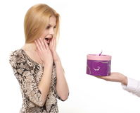 Blond young smiling woman getting a gift in box Stock Image