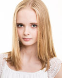 Blond Young Teenage Girl Dressed In White in the Studio Stock Images