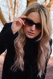 Blond young woman Stock Photos
