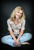 Blond young woman stock images