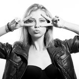 Blond young woman beautiful sexy provocative girl. Black and white photography of blond beautiful sexy provocative girl in black leather jacket having fun Stock Image