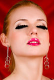 Blond young woman with big eyelashes Stock Photography