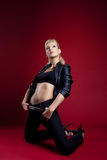 Blond young woman in black leather jacket Royalty Free Stock Photos