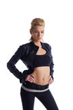 Blond young woman in black leather jacket. Young beauty woman posing in rock leather jacket on red Stock Photography