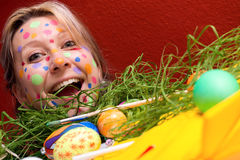 Blond young woman with colorful Easter eggs Stock Images