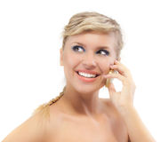 Blond young woman communicates by Royalty Free Stock Images