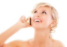 Blond young woman communicates by. Phone, isolated on white background Royalty Free Stock Photography