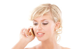 Blond young woman communicates by phone Stock Photography