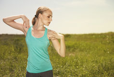 blond young  woman exercising in the outdoors yoga photo Stock Photography