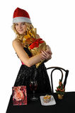 Blond young woman with gift bag Stock Images