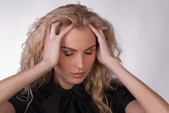 Blond young woman with a headache Stock Photography