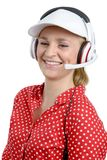 Blond young woman with headset and white cap Stock Photo