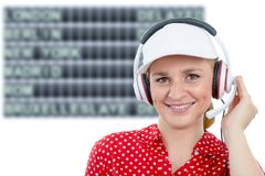 Blond young woman with headset and white cap Royalty Free Stock Image