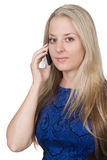 Blond young woman holding a mobile phone Royalty Free Stock Images
