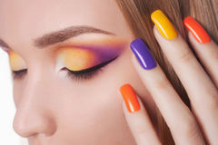 Blond young woman with manicure and make-up Stock Photography