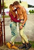 Blond young woman model and handsome muscled man outdoors. Portrait of beautiful couple. Sexy stylish blond young women model with bright makeup with perfect Stock Images