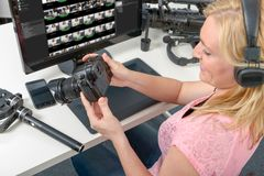 Blond young woman photographer working with computer and graphic Stock Images