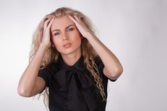 Blond young woman with a pounding headache Royalty Free Stock Photography