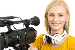 Blond young woman with professional video camcorder, on white Royalty Free Stock Photos