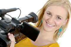 Blond young woman with professional video camera, on white. A blond young woman with professional video camera, on white Royalty Free Stock Photography