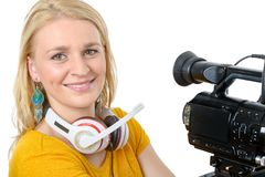 Blond young woman with professional video camera, on white. A blond young woman with professional video camera, on white Stock Image