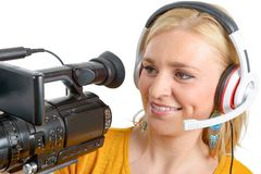 Blond young woman with professional video camera, on white. A blond young woman with professional video camera, on white Stock Images