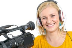 Blond young woman with professional video camera, on white. A blond young woman with professional video camera, on white Royalty Free Stock Photos