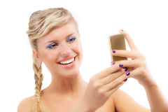 Blond young woman read sms on phone Stock Image