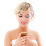 Blond young woman reads message. Isolated on white background Stock Photography
