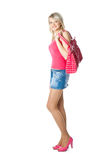 Blond young woman in red with red bag Royalty Free Stock Photo