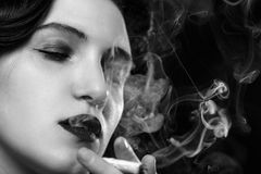 Woman smoking joint royalty free stock photography