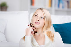 Blond Young Woman Thinking With Glasses Royalty Free Stock Photo