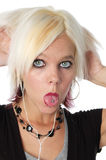 Blond, Zunge heraus haftend Lizenzfreies Stockbild