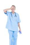 blonde Ärztin, die deprimiert ist Lizenzfreies Stockfoto