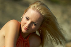Blonde. The young beautiful girl on the nature Royalty Free Stock Photography