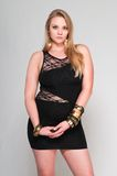 Blonde. Pretty young plus size blonde in a black dress Stock Photo