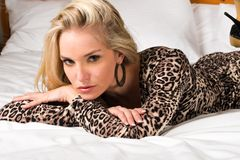 Blonde. Pretty blonde woman in a leopard print dress Royalty Free Stock Photos