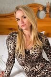 Blonde. Pretty blonde woman in a leopard print dress Royalty Free Stock Images