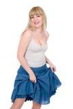 Blonde alegre com a saia levantada Foto de Stock Royalty Free