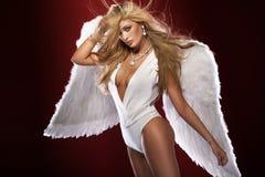 Blonde angel posing. Stock Photo