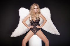 Blonde angel smiling. Stock Photography