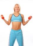 Blonde anhebende Gewichte Lizenzfreie Stockbilder