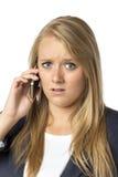 Blonde anrufende ernste Frau Stockfotografie