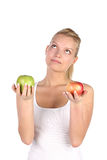 Blonde with apple Stock Images