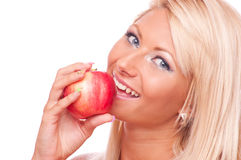 Blonde with apple Royalty Free Stock Photography