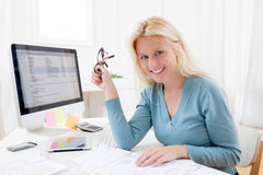 Blonde architect watching blueprint at the office Royalty Free Stock Images